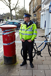 "© Licensed to London News Pictures.  13/02/2014. OXFORD, UK. A PCSO guards the scene after a suspect package was received at the Army recruitment office in St Giles, Oxford. The package was one of seven received across the country in the last two days and has been described as ""crude but potentially viable with hallmarks of Northern Ireland-related terrorism. Photo credit: Cliff Hide/LNP"