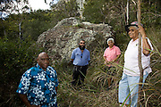 Repatriation of aboriginal remains from Europe and the U.S. to back to Australia story..Lollyd Willie of Jguri, Bob Muir of Woppaburra Ethel Speedy Dharumbal and Connie Coolwell at Chinamans Rock underneath Mt Wheeler. Refered to as Gawula, place of ceremonies.
