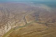 Alameda Creek carves a path through a muddy delta to reach the San Francisco Bay near Oakland, California.