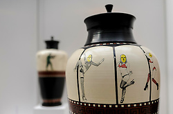 © Licensed to London News Pictures. 08/04/2016. London, UK. Ceramicist Raymond Church shows a quirky touch to ancient Greek vases.  The leading international fair for contemporary ceramics, Ceramic Art London 2016, opens at its new venue of Central Saint Martins, King's Cross.  88 emerging and established ceramicists from around the world are presenting and their latest works for sale to the public with prices ranging from £30 to £10,000. Photo credit : Stephen Chung/LNP
