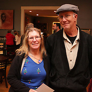 Annette Cook, left, and John Cook pose for a picture Sunday December 21, 2014 during the Brooklyn Arts District Christmas party at Canape in Wilmington, N.C. (Jason A. Frizzelle)