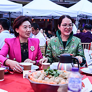 黄萍 (Ping Huang)is a General Secretary of London Chinatown Chinese Association in green dress and her community of Zhejiang UK Association attend the Moon festival - The big feast for the chinese community and the 70th Anniversary of China at Chinatown Square on the 15th September 2019, London, UK.