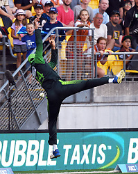 Pakistan's Umar Amin attempts to save against  six from New Zealand's Colin Munro in the first T20 International Cricket match, Westpac Stadium, Wellington, New Zealand, Monday, January 22, 2018