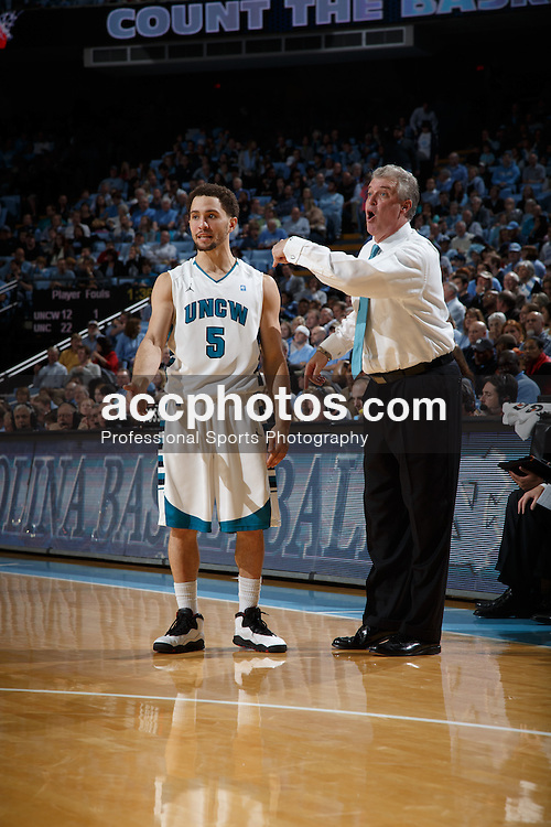 CHAPEL HILL, NC - DECEMBER 31: Ben Eblen #5 of the UNC Wilmington Seahawks talks with head coach Buzz Peterson while playing the North Carolina Tar Heels on December 31, 2013 at the Dean E. Smith Center in Chapel Hill, North Carolina. North Carolina defeated UNC Wilmington 84-51. (Photo by Peyton Williams/UNC/Getty Images) *** Local Caption *** Ben Eblen;Buzz Peterson