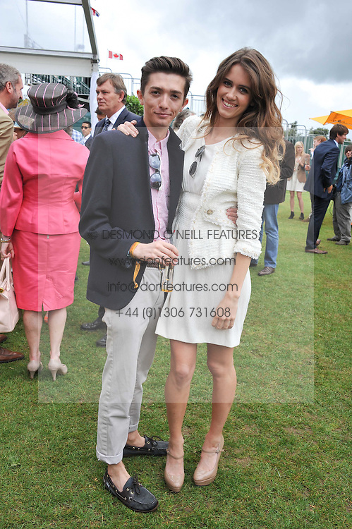ALEX LEE and JADE WILLIAMS - Sunday Girl at the 2011 Veuve Clicquot Gold Cup Final at Cowdray Park, Midhurst, West Sussex on 17th July 2011.