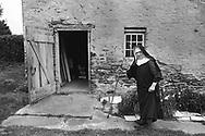 Sister Macrina Goyda takes time from gardening to looks for her cat near the shed at Sisters of Saint Basil The Great Tuesday May 1, 1990 in Jenkintown, Pennsylvania. (Photo by William Thomas Cain/Cain Images)