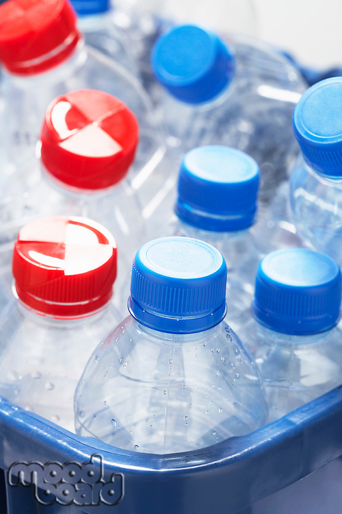 Empty plastic bottles in container close-up