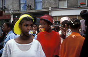 Girls with dummys in their mouths, Notting Hill Carnival, UK  1994