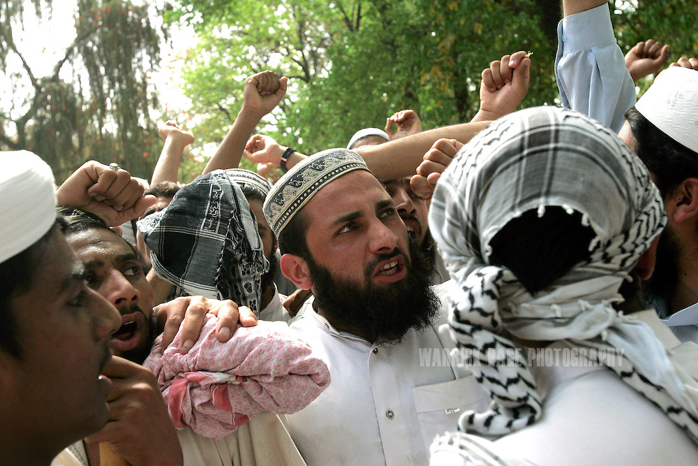 "Religious students of the radical Islamist Red Mosque chant while thousands of CDs and DVDs are torched in an ""anti-vice"" drive after Friday prayers in Islamabad, Pakistan, Friday, April 6, 2007. (Photo by Warrick Page)"