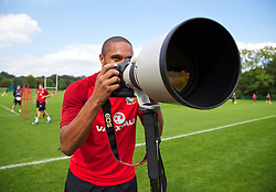 CARDIFF, WALES - Tuesday, September 3, 2013: Wales' captain Ashley Williams takes a photograph during a training session at the Vale of Glamorgan ahead of the 2014 FIFA World Cup Brazil Qualifying Group A match against Macedonia. (Pic by David Rawcliffe/Propaganda)