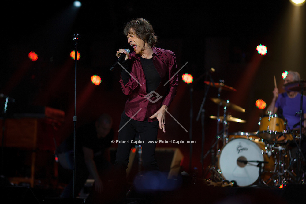 Mick Jagger of The Rolling Stones at the 12-12-12 fundraising concert to aid the victims of Hurricane Sandy, will take place on December 12, 2012 at Madison Square Garden. The concert featured The Rolling Stones, Bon Jovi, Eric Clapton, Dave Grohl, Billy Joel, Alicia Keys, Chris Martin, Bruce Springsteen & the E Street Band, Eddie Vedder, Roger Waters, Kanye West, The Who, and Paul McCartney. All the proceeds went go to the Robin Hood Relief Fund. Robin Hood, the largest independent poverty fighting organization in the New York area, will insure that every cent raised will go to non-profit groups that are helping the tens of thousands.of people throughout the tri-state area who have been affected by Hurricane Sandy...Photo © Robert Caplin..