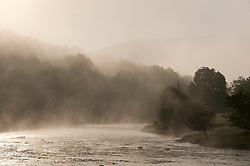 © Licensed to London News Pictures. 04/05/2019. Builth Wells, Powys, Wales, UK. Mist hangs over the river Wye at Builth Wells in Powys, Wales, UK. After a very cold night with temperatures dropping to 3 deg C in Powys, the valleys are filled with early morning mist. Photo credit: Graham M. Lawrence/LNP