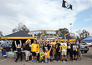A group of Pittsburgh Steelers fans cheer as they tailgate in the parking lot with Qualcomm Stadium in the background before the Pittsburgh Steelers 2015 NFL week 5 regular season football game against the San Diego Chargers on Monday, Oct. 12, 2015 in San Diego. The Steelers won the game 24-20. (©Paul Anthony Spinelli)