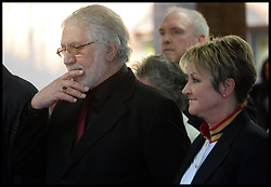 Former Radio 1 DJ Dave Lee Travis leaves Southwark Crown Court, London, United Kingdom, with his wife Marianne, after being told he is to face a retrial over sexual assault claims, Monday, 24th February 2014. Picture by Andrew Parsons / i-Images