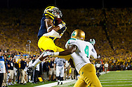 September 10, 2011; Ann Arbor, MI, USA; Michigan Wolverines wide receiver Roy Roundtree (12) catches a pass for a touchdown over Notre Dame Fighting Irish cornerback Gary Gray (4) in the fourth quarter to win the game at Michigan Stadium.
