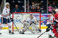 KELOWNA, BC - MARCH 09:  Montana Onyebuchi #5 and Dylan Garand #30 of the Kamloops Blazers defends the net against the Kelowna Rockets at Prospera Place on March 9, 2019 in Kelowna, Canada. (Photo by Marissa Baecker/Getty Images)