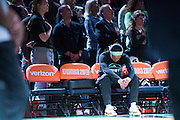 Brittany Boyd #15 of the New York Liberty sits on the bench with her head bowed during the National Anthem before tipoff against the Phoenix Mercury during the second round of the WNBA Playoffs at Madison Square Garden in New York on September 24, 2016. (Cooper Neill for The New York Times)
