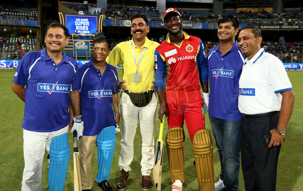 Royal Challengers Bangalore player Daren Sammy with Yes Bank team after the  match 46 of the Pepsi IPL 2015 (Indian Premier League) between The Mumbai Indians and The Royal Challengers Bangalore held at the Wankhede Stadium in Mumbai, India on the 10th May 2015.<br /> <br /> Photo by:  Sandeep Shetty / SPORTZPICS / IPL