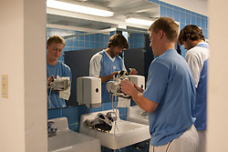 08 March 2008: North Carolina Tar Heels men's lacrosse goalkeeper Andrew Moss (7) and attackman Ian Morrison (2) clean their shoes pregame before playing the Notre Dame Fighting Irish in Chapel Hill, NC.