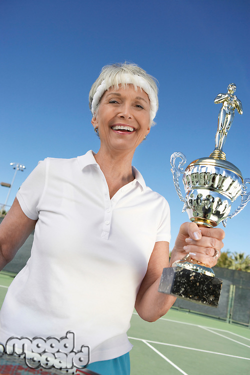 Smiling Woman with Her Tennis Trophy