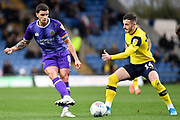 Shrewsbury Town midfielder Oliver Norburn (8) passes under pressure from Oxford United midfielder Anthony Forde (14) during the EFL Sky Bet League 1 match between Oxford United and Shrewsbury Town at the Kassam Stadium, Oxford, England on 7 December 2019.