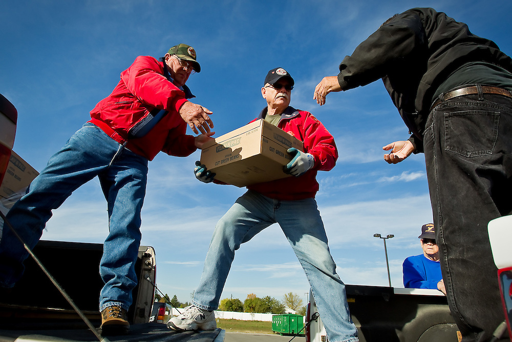 Tom Wambolt, left, and Duke Gaffney, both with the Pappy Boyington Detachment of the Marine Corps League, helps Dave Sheridan, with American Legion Post 14 in Coeur d'Alene, load his truck Thursday with more than 1,000 pounds of canned vegetable that will be delivered to the State Veterans Home in Lewiston. John Dunlap, American Legion Post 143 commander, organized the unloading and packing from the Post Falls location. The effort was coordinated by local veterans groups which have been making the annual 100-mile-plus convoy south with about $5,000 worth of food for the past 21 years.