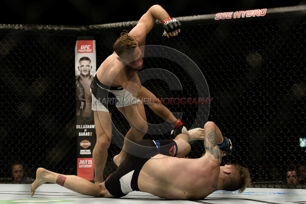 GLASGOW, SCOTLAND, JULY 18, 2015: Mikael Lebout (white shorts with black stripe) defeats Teemu Packalen by judge's decision during UFC Fight Night 72 inside the SSE Hydro Arena in Glasgow. (Martin McNeil for ESPN)