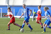Brighton's Jay Blackie flicks a pass to Kirsty Barton during the FA Women's Premier League Cup quarter-final match between Brighton Ladies and Charlton Athletic WFC at The American Express Elite Football Performance Centre, Lancing, United Kingdom on 1 March 2015. Photo by Geoff Penn.