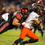 10 November 2018: San Diego State Aztecs linebacker Ronley Lakalaka (39) brings down UNLV Rebels wide receiver Brandon Presley (80) after a short gain in the first quarter. The Aztecs lost 27-24 to UNLV Saturday night at SDCCU Stadium falling a game behind Fresno State in the conference standings.