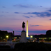 The Ulysses S. Grant memorial near the US Capitol is framed along with the Washington Monument against a summer evening sky in Washington, DC.