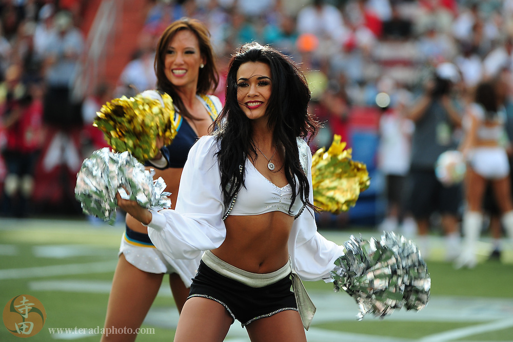January 30, 2011; Honolulu, HI, USA; Oakland Raiders cheerleader Natalie Pricco (front) and San Diego Chargers cheerleader Tiffany Chen (back) perform during the third quarter of the 2011 Pro Bowl at Aloha Stadium. The NFC defeated the AFC 55-41.