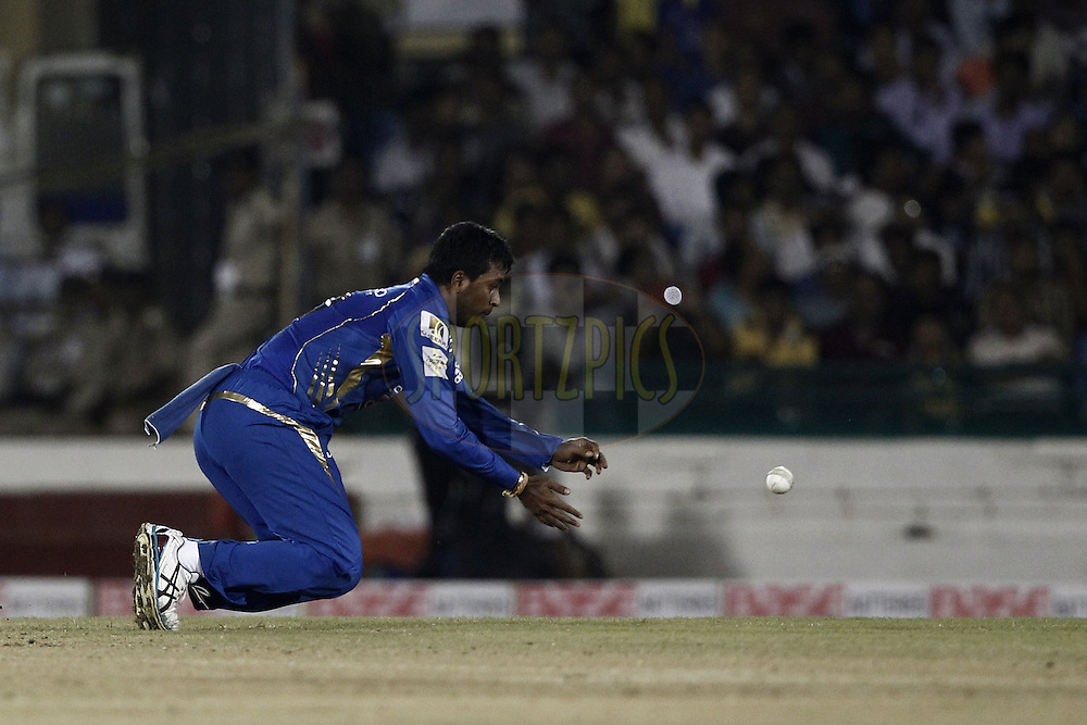 Pragyan Ohja of the Mumbai Indians  during the qualifier 4 match of the Oppo Champions League Twenty20 between the Mumbai Indians and the Southern Express held at the Chhattisgarh International Cricket Stadium, Raipur, India on the 14th September 2014<br /> <br /> Photo by:  Deepak Malik / Sportzpics/ CLT20<br /> <br /> <br /> Image use is subject to the terms and conditions as laid out by the BCCI/ CLT20.  The terms and conditions can be downloaded here:<br /> <br /> http://sportzpics.photoshelter.com/gallery/CLT20-Image-Terms-and-Conditions-2014/G0000IfNJn535VPU/C0000QhhKadWcjYs