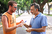Israel, Tel Aviv, Israeli actor Moshe Ivgy (right) soliciting support from passers-by