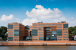 Modern office buildings on waterfront of River Elbe at Holzhafen viewed from tour boat in Hamburg Germany