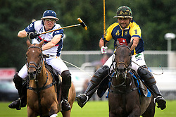England (left) and Commonwealth polo players during the Royal Salute Coronation Cup polo at Windsor Great Park in Surrey.