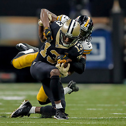 Dec 23, 2018; New Orleans, LA, USA; New Orleans Saints wide receiver Michael Thomas (13) is tackled by Pittsburgh Steelers safety Terrell Edmunds (34) during the second quarter at the Mercedes-Benz Superdome. Mandatory Credit: Derick E. Hingle-USA TODAY Sports
