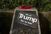 Detail of a war memorial outside the London US Embassy at the Stop Trump's Muslim ban demonstration on 4th February 2017 in London, United Kingdom. The protest was called on by Stop the War Coalition, Stand Up to Racism, Muslim Association of Britain, Muslim Engagement and Development, the Muslim Council of Britain, CND and Friends of Al-Aqsa. Thousands of demonstrators gathered to demonstrate against Trump's ban on Muslims, saying it must be opposed by all who are against racism and support basic human rights, and for Theresa May not to collude with him.