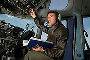 A U.S. Air Force pilot conducts his preflight checklist during engine start up on the flightdeck...Air Force aircraft transport most of the supplies and military equipment to the combat zone. Specialists must weigh, sort and load all of the gear before it heads to its location abroad. Air Force loadmasters and pilots ensure the safe transport of all equipment required in the field.