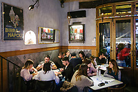 "NAPLES, ITALY - 8 DECEMBER 2017: Customers are seen here at Pizzeria Gino Sorbillo in Naples, Italy, on December 8th 2017.<br /> <br /> On Thursday December 7th 2017, UNESCO added the art of Neapolitan ""Pizzaiuolo"" to its list of Intangible Cultural Heritage of Humanity.<br /> <br /> The art of the Neapolitan 'Pizzaiuolo' is a culinary practice comprising four different phases relating to the preparation of the dough and its baking in a wood-fired oven, involving a rotatory movement by the baker. The element originates in Naples, the capital of the Campania Region, where about 3,000 Pizzaiuoli now live and perform. Pizzaiuoli are a living link for the communities concerned. There are three primary categories of bearers – the Master Pizzaiuolo, the Pizzaiuolo and the baker – as well as the families in Naples who reproduce the art in their own homes. The element fosters social gatherings and intergenerational exchange, and assumes a character of the spectacular, with the Pizzaiuolo at the centre of their 'bottega' sharing their art.<br /> <br /> In Naples, pizza makers celebrated the victory by giving away free pizzas."