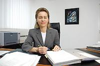 12 DEC 2005, BERLIN/GERMANY:<br /> Ursula von der Leyen, CDU, Bundesfamilienministerin, an ihrem Schreibtisch, in ihrem Buero, Bundesministerium fuer Familie, Senioren, Frauen, und Jugend<br /> Ursula von der Leyen, Federal Minister for family, Seniors, Women and Youth, in her office<br /> IMAGE: 20051212-01-013<br /> KEYWORDS: Büro