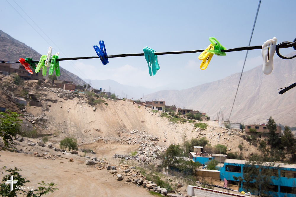 A clothesline helps frame an area damaged by landslides near Huayaringa, Peru, on Tuesday, April 7, 2015. LCMS Communications/Erik M. Lunsford