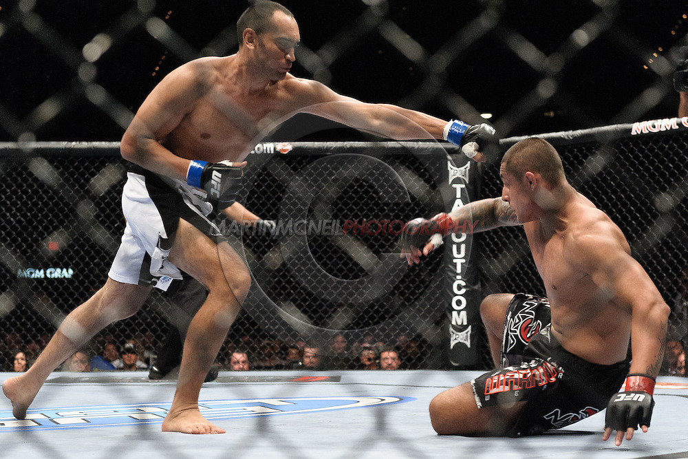"LAS VEGAS, NEVADA, MAY 24, 2008: Antonio Mendes (left) pursues a stunned Thiago Silva during ""UFC 84: Ill Will"" inside the MGM Grand Garden Arena in Las Vegas"