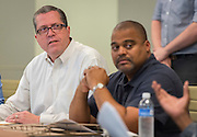 Architects, Houston ISD staff and PAT members discuss the design of Jordan High School during a Jordan and Madison High School design charrette at the Houston Food Bank, May 29, 2015.