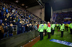 WIGAN, ENGLAND - Monday, February 19, 2018: Greater Manchester Police officers face off with Manchester City supporters after the club's 1-0 defeat during the FA Cup 5th Round match between Wigan Athletic FC and Manchester City FC at the DW Stadium. (Pic by David Rawcliffe/Propaganda)
