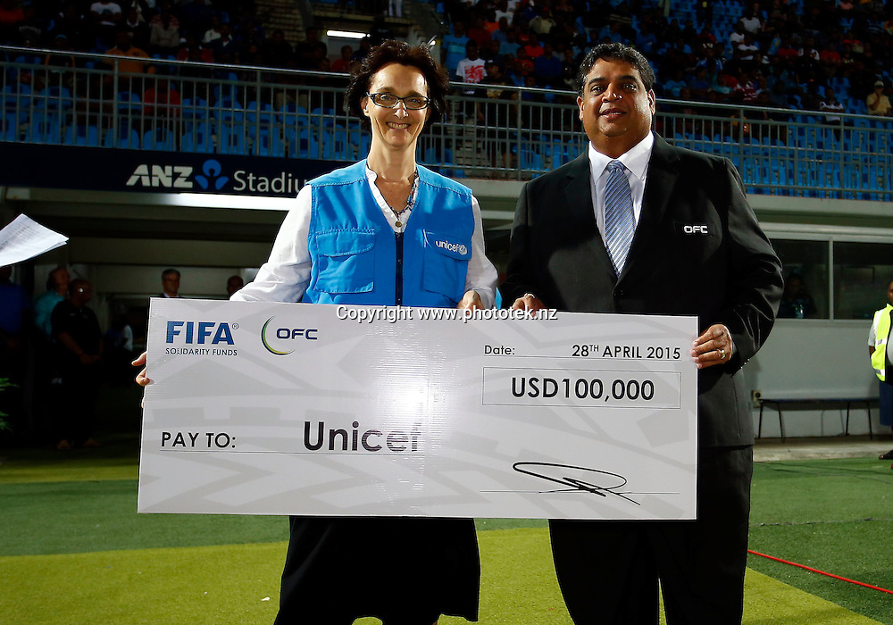 Fiji FA President Rajesh Patel presents UNICEF with a cheque for $100,000.00 for Cyclone Pam relief. 2015 Fiji Airways OFC Champions League Final, Auckland City FC v Team Wellington, ANZ Stadium, Suva, Sunday 26th April 2015. Photo: Shane Wenzlick / www.fb.phototek.nz