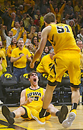 Iowa Hawkeyes forward Luka Garza (55) is pumped up after making a basket while being fouled as forward Nicholas Baer (51) runs over to him up during the second half of their B1G basketball game at Carver-Hawkeye Arena in Iowa City on Friday, Nov. 30, 2018.