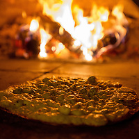 "Chef Leone Palagi cooks the ""Thin Crust Pear & Gorgonzola Pizza"" at Mario's Place on Mission Inn Ave in Riverside, Aug. 28, 2014.  (Eric Reed/Redlands Magazine)"