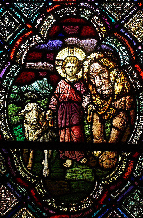 Stained glass of young Jesus with lamb and lion inside chapel at St. Joan of Arc Church in Nashotah. (Photo by Sam  Lucero)