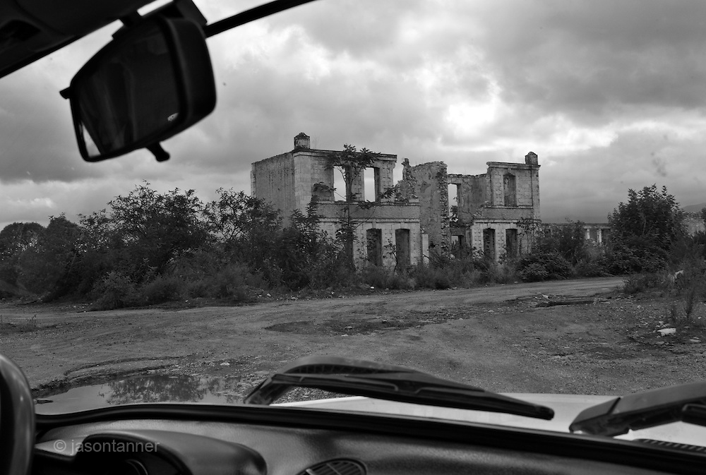 The abandoned city of Agdam north east of Stepanakert. The city was once home to 100,000 people until fighting bewteen local fedayeen units (Armenian) and Azeri units broke out between 1989-1994. The city was captured by Armenian backed forces in 1994 and looted of all materials. The area remains abondoned due to the close proximity of the front line where both Azeri ad Armenian forces remain on constant standby for conflict...Only one family was observed living illegally in the city, Other locals visit to scavange copper and building materials from the remains of destroyed buildings. Unexploded ordnance (UXO) is a still a hazard more than 14 years after the end of the war...Nagorno Karabakh still legally remains part of Azerbaijan. It is not officially recoginsed as a sovereign state and is an independent state only according to the Nagorno Karabakh Declaration of Independence and can only be visited via Armenia.