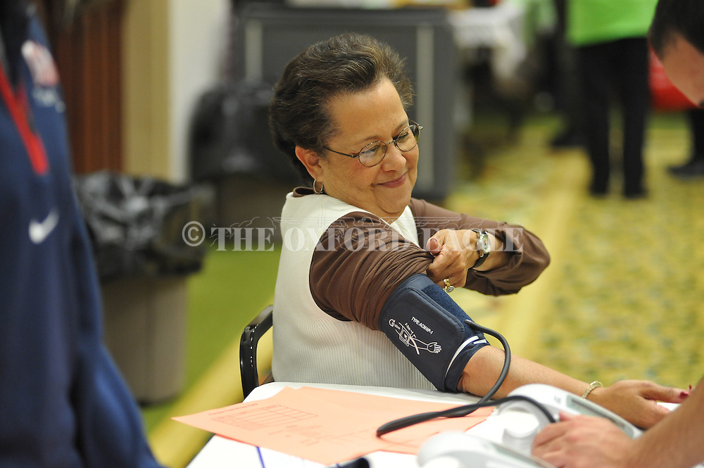 Millie Stivers has her blood pressure checked during a 50+ Health & Wellness Expo at the Oxford Conference Center in Oxford, Miss. on Thursday, April 12, 2012.